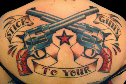 Traditional guns tattoo by Greg Foster.
