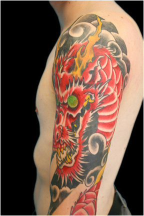 Dragon tattoo by Greg Foster.