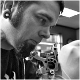 Greg Foster, co-owner and tattoo artist at Custom Tattoo, Milwaukee